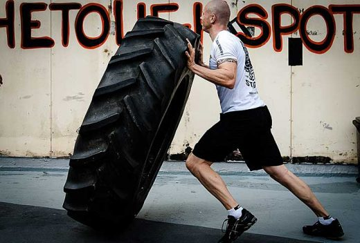 Man training with heavy tyre